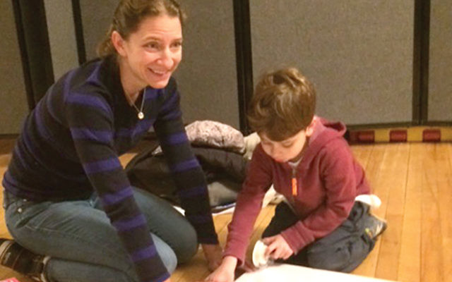 Lauren Barkan and her son, Aden, at present-wrapping event at Park Slope synagogue.  Bonnie Kerber