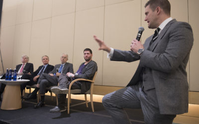 Richard Spencer (R) and panelists at an alt-right conference hosted by the National Policy Institute in Wash. D.C. in Nov. JTA