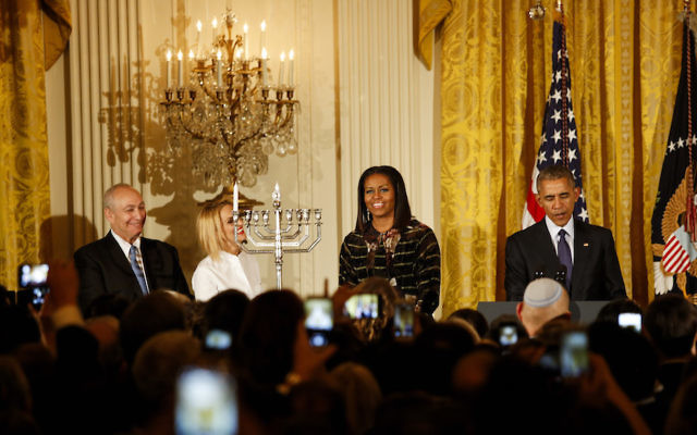 President Barack Obama, with wife Michelle, speaking at a Hanukkah reception in the White House. JTA
