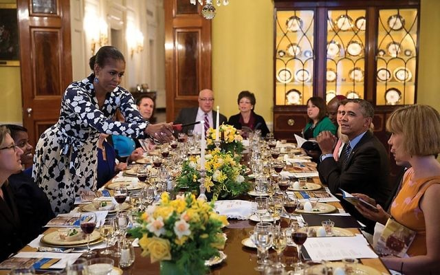 Freedom's light: First Lady Michelle Obama and President Obama hosting a White House seder.   WIKIMEDIA COMMONS