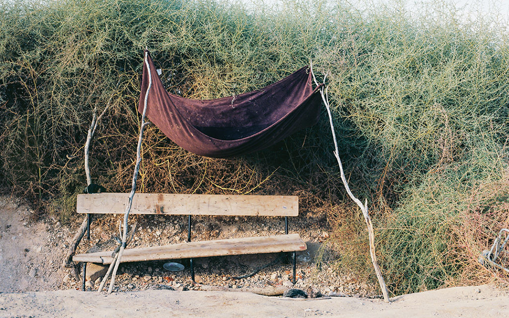 """""""Abdelrazik's Bench"""" from photographer Ron Amir's Israel Museum show about asylum seekers in Holot. Courtesy of Israel Museum"""