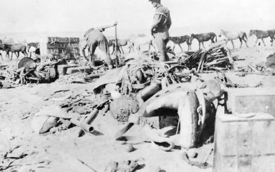 Members of the 12th Light Horse regiment survey damaged items and captured Turkish equipment from the battle of Beersheba. Courtesy of Australian War Memorial