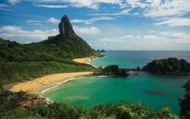 Jagged green peaks ring the island of Fernando de Noronha. Wikimedia Commons