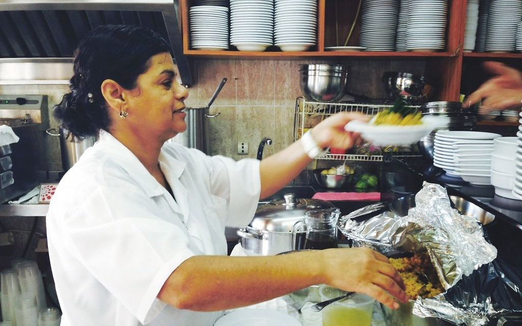 "Suheila al Hindi in the kitchen of her Acre hummus restaurant in ""Hummus! The Movie."" Chicago Festival of Israeli Cinema"