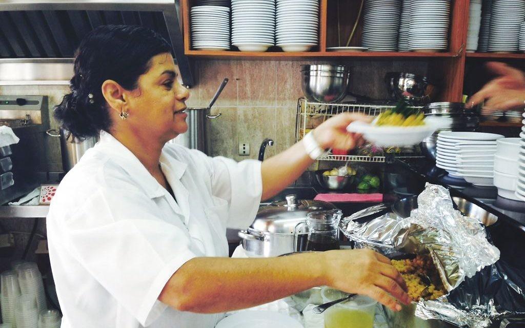 "Suheila al Hindi in the kitchen of her Acre hummus restaurant in ""Hummus! The Movie."" Chicago Festival of Israeli Cinema"