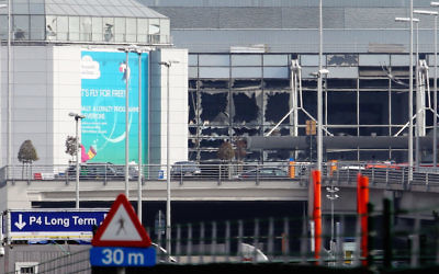 A view of bomb damage as passengers are evacuated from Zaventem Bruxelles International Airport after a terrorist attack on in Brussels, Belgium, March 22, 2016. (Sylvain Lefevre/Getty Images)