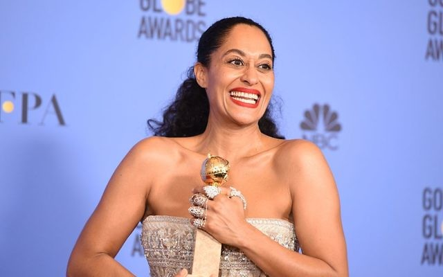 Tracee Ellis Ross poses with the award for Best Actress in a Comedy TV series for her role in Black-ish, at the 74th annual Golden Globe Awards, January 8, 2017. Getty Images