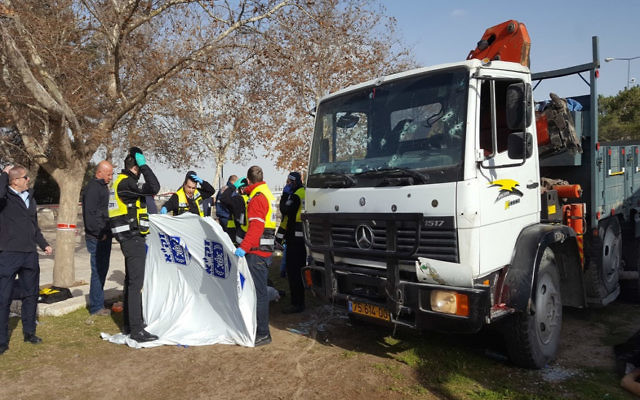 Members of ZAKA search and rescue organization gather human remains from a truck ramming attack in eastern Jerusalem that killed 4 Israeli soldiers and injured 15 others on Jan. 8, 2017. JTA