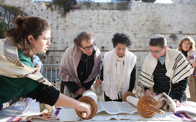 An earlier Women of the Wall Torah reading at the Kotel. Wikimedia Commons