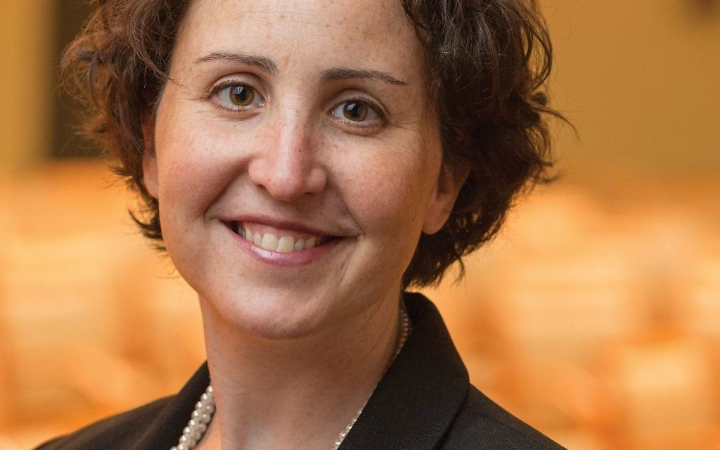 "Rabbi Rachel Bregman, is a leader in the movement of people who study for their conversions to Judaism via online educational platforms. ""Online conversion"" can help make Judaism more accessible to those in remote locations, but everyone isn't on board. Bregman photo: Ellis Vener / Illustration By Lior Zaltzman"