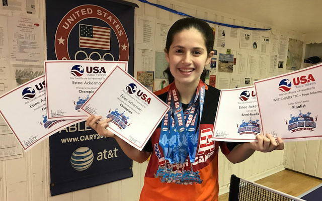 Estee Ackerman holding certificates representing the five medals she won in this month's U.S. Open in table tennis. JTA