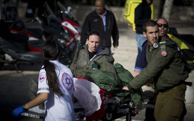 Medics attending to the injured at the scene where a truck rammed a group of Israeli soldiers in eastern Jerusalem, Jan. 8, 2017. JTA