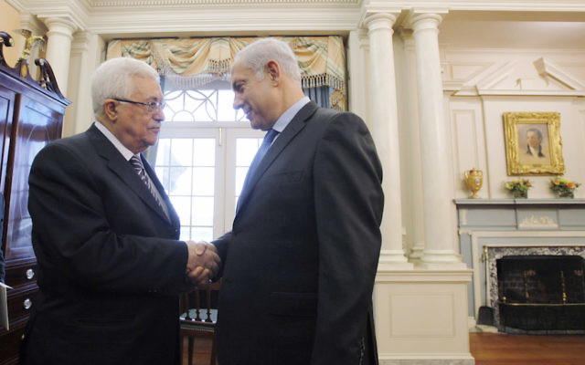 Palestinian Authority President Mahmoud Abbas, left, shaking hands with Israeli Prime Minister Benjamin Netanyahu before holding direct peace talks at the State Department in Washington, D.C., Sept. 2, 2010. (Jason Reed-Pool/Getty Images)