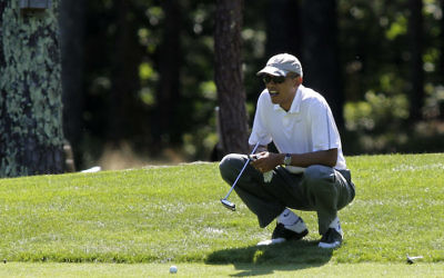 President Barack Obama golfing at Oak Bluffs, Mass., Aug. 9, 2014. (Matthew Healey/Bloomberg/Getty Images)