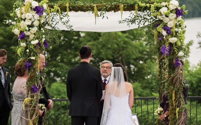 Rabbi Seymour Rosenbloom officiating at the 2014 wedding of his stepdaughter and her fiancé.  Courtesy of Stefanie Fox