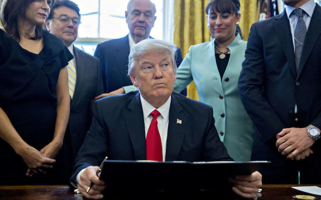 President Donald Trump signing an executive order in the Oval Office of the White House surrounded on Jan. 30, 2017. Getty Images
