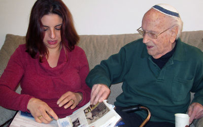Jancy Benvenishti, the Jerusalem coordinator for the International Fellowship of Christians and Jews, visits Avraham Marek, a 103-year-old Holocaust survivor, in his Jerusalem home. Benvenishti's organization assists needy elderly Jews, including thousands of Holocaust survivors, around the world. RNS photo by Michele Chabin