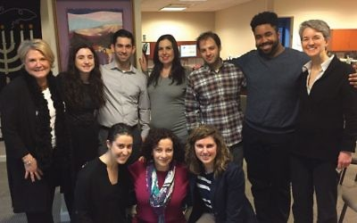 Evan Miller, standing, third from left, and Marques Hollie, standing, second from right with other JewV'Nation fellows at a leadership development seminar. Deborah Fishman is not pictured.  Courtesy of URJ