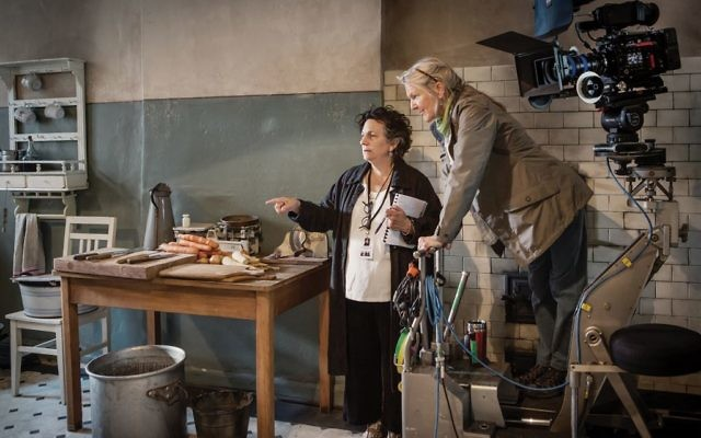 The movie set in Poland recreates the Warsaw Ghetto. Director Roberta Grossman, above left, and cinematographer Dynanna Taylor in a simulated ghetto kitchen; and a Warsaw Ghetto street scene.   Photos by Anna Wloch