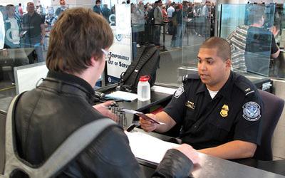 A customs check at a U.S. airport. Via Flickr