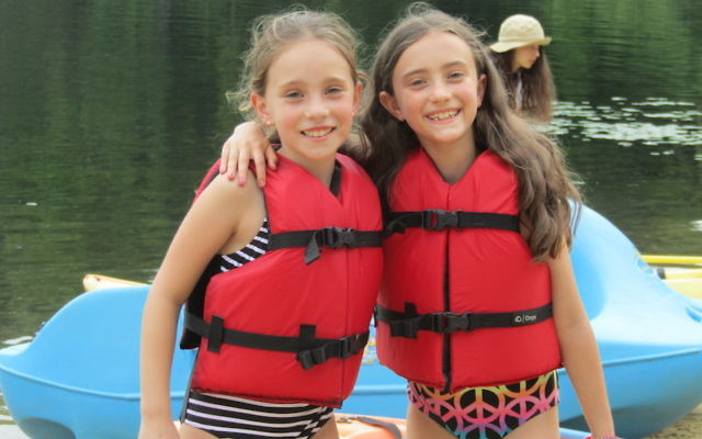 Two young campers at Camp Ramah in the Berkshires enjoy the waterfront. At the camp, those entering third grade can try out a seven-day session. (Courtesy of Camp Ramah in the Berkshires)