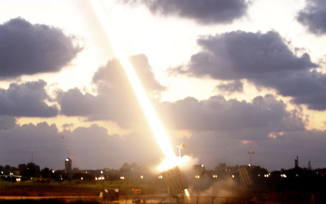 An Iron Dome Missile Defense battery set up near the Southern israeli town of Ashdod fires an intercepting missile on July 16, 2014. JTA