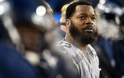 Michael Bennett #72 of the Seattle Seahawks watches action during the 1st half of a game against the Green Bay Packers at Lambeau Field on December 11, 2016 in Green Bay, Wisconsin.  JTA