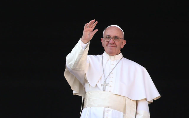 Pope Francis waving from the balcony of St. Peter's Basilica in Vatican City, Dec. 25, 2015. (Franco Origlia/Getty Images)