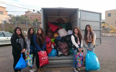 Israeli volunteers packing winter supplies to be delivered to Syrian Refugees. JTA