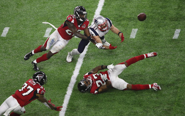 Julian Edelman, in white uniform, of the New England Patriots making an extraordinary and possibly game-saving catch in the fourth quarter of Super Bowl LI at NRG Stadium in Houston, Feb. 5, 2017. (Ezra Shaw/Getty Images)