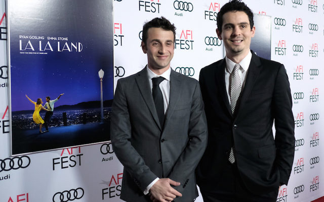 HOLLYWOOD, CA - NOVEMBER 15:  Composer Justin Hurwitz (L) and director Damien Chazelle attend the premiere of 'LA LA LAND' at AFI Fest 2016, presented by Audi at The Chinese Theatre on November 15, 2016 in Hollywood, California.  (Photo by Chris Weeks/Getty Images for Audi)