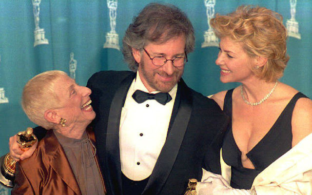 Steven Spielberg (C) poses with his wife actress Kate Capshaw (R) and his mother Leah Adler (L) during the 66th Annual Academy Awards ceremony after winning the 1993 Oscars for best director and best picture for his movie 'Schindler's List.' Getty Images