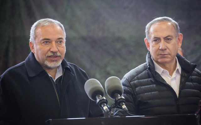 Israeli Defense Minister Avigdor Liberman, left, and Prime Minister Benjamin Netanyahu speaking to the media after viewing the weapons cache discovered at a factory in the West Bank city of Hebron, Jan. 10, 2017. (Hadas Parush/Flash90)