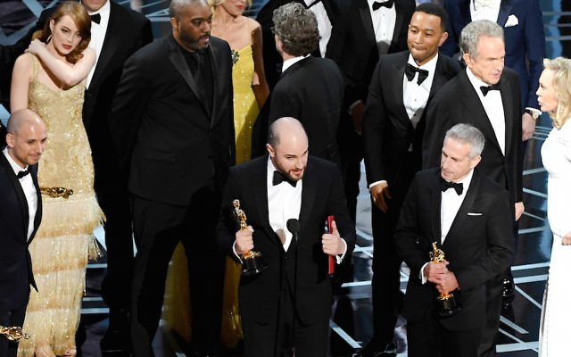 HOLLYWOOD, CA - FEBRUARY 26:  (L-R) Prior to learning of a presentation error, 'La La Land' producers Fred Berger, Jordan Horowitz and Marc Platt accept the Best Picture award for 'La La Land' (later awarded to actual Best Picture winner 'Moonlight') onstage during the 89th Annual Academy Awards at Hollywood & Highland Center on February 26, 2017 in Hollywood, California.  (Photo by Kevin Winter/Getty Images)