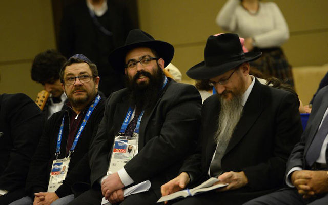 Rabbis Ari Edelkopf, with black beard, and Berel Lazar, right, listen to a speech at a reception of the Federation of Jewish Communities of Russia in Sochi, Russia, Feb. 9, 2017. (Courtesy of Federation of Jewish Communities)