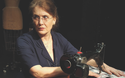 The dressmaker, Maria, in 'The Dressmaker's Secret,' set in 1960s Romania. Courtesy of William Dean