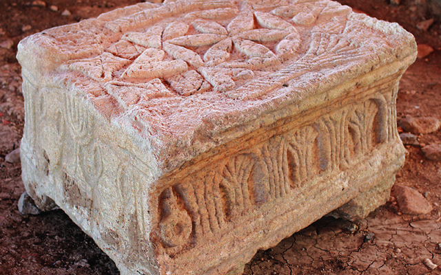 The Magdala Stone was discovered by archaeologists unearthing a first-century synagogue. A menorah can be seen on the left side of the stone. This is part of the joint exhibition in Rome. Photo courtesy of Magdala.org (RNS)