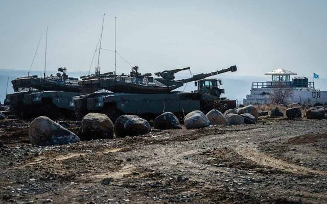 IDF soldiers at the Israeli-Syrian border in the Golan Heights. Basel Awidat/Flash90