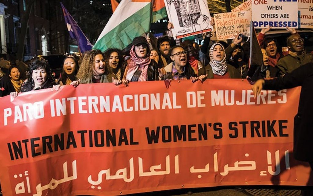 Women wave Palestinian flags at a New York City park on March 8 to mark International Women's Day. The feminist movement, Jewish women argue, is unfairly tarring Zionism. Getty Images