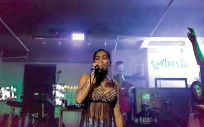 Cryssy Bandz, right,  rapping at ShabBattle.  SPLASH/TIAGO VEIGA