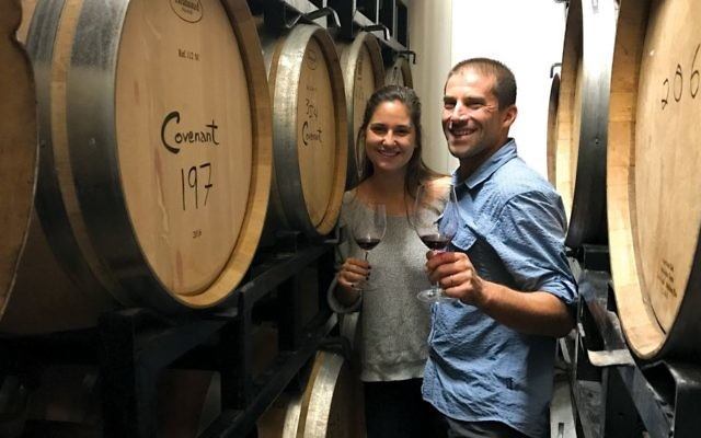 Ari Erle, an American-Israeli émigré winemaker who at one time worked in Napa Valley, with the Morgans' daughter Zoe, the company's Israel sales and media manager. Courtesy of Covenant Wines