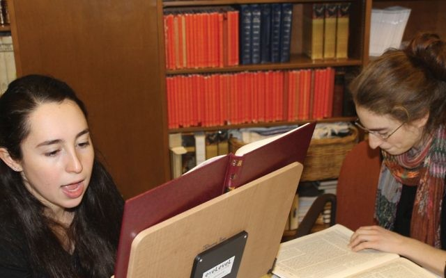 Johanna Press, left, and Noa Albaum studying Talmud together at Hadar. Both are fellows in its yearlong study program.