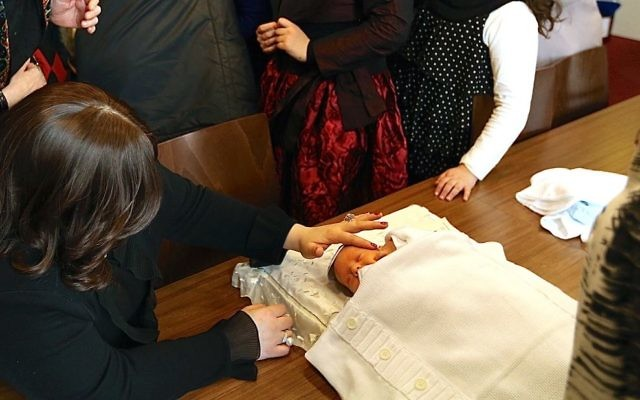 An orthodox bris ceremony. Getty Images