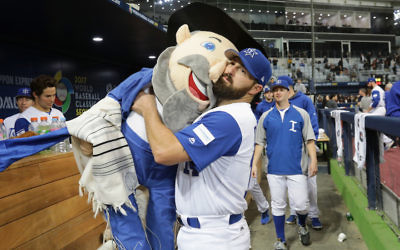Cody Decker of Team Israel holding team mascot the Mensch on a Bench after the World Baseball Classic game against the Netherlands in Seoul, South Korea, March 9, 2017. (Chung Sung-Jun/Getty Images)