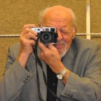 David Rubinger, Israeli photojournalist, with his Leica camera. Wikimedia Commons/Shmuel.browns