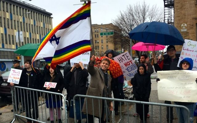JQY executive director Mordechai Levovitz (holding flag) and about 30 other people showed up to counter-protest Westboro Baptist Church's protest. Chaim Levin/JW