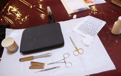Instruments used in the Jewish circumcision ceremony lie on a table prior to the circumcision of baby. Getty Images