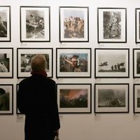 "A spectator takes in David Rubinger's photographs at the ""Eretz Israel: The Birth Of A Nation Private View,"" exhibition in London, in 2006. Gareth Cattermole/Getty Images"