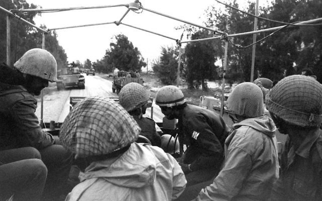 Israeli troops move toward the northern frontier to stem the Syrian attack on the Golan Heights 08 October 1973. DAVID RUBINGER/AFP/Getty Images