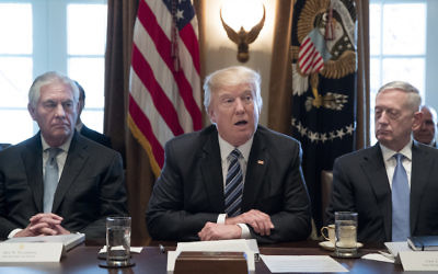 President Donald Trump is flanked by Secretary of State Rex Tillerson, left, and Secretary of Defense James Mattis at a White House Cabinet meeting, March 13, 2017. JTA